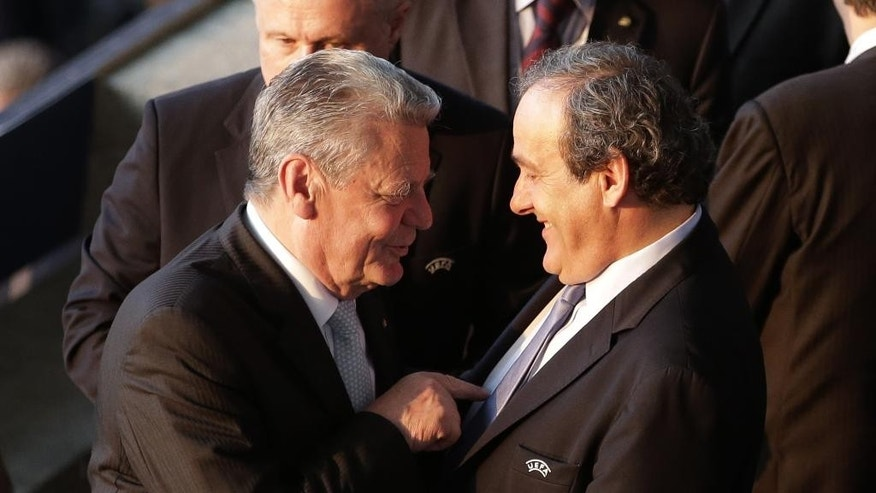 German President Joachim Gauck, left, speaks with UEFA President Michel Platini, during the Champions League final soccer match between Juventus Turin and FC Barcelona at the Olympic stadium in Berlin Saturday, June 6, 2015. (AP Photo/Michael Sohn)