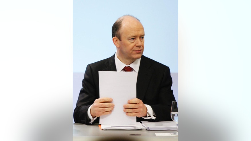 FILE - In this Feb. 10, 2009 file photo John Cryan, then Chief Financial Officer of the UBS, holds files during a news conference in Zurich, Switzerland. Deutsche Bank said Sunday, June 7, 2015 that Jain and Fitschen will resign as Co-CEOs.  John Cryan will succeed Jain in July 2015 and will become the sole CEO in May 2016. (Steffen Schmidt/Keystone via AP)
