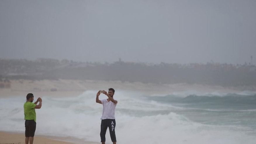 A man takes a selfie at El Medano Beach before the arrival of Hurricane Blanca, in Cabo San Lucas, Mexico, Sunday June 7, 2015. The unpredictable storm strengthened rapidly to a Category 4 storm on Saturday, but the U.S. National Hurricane Center says it has since weakened to Category 1 with top winds near 90 mph. (AP Photo/Eduardo Verdugo)