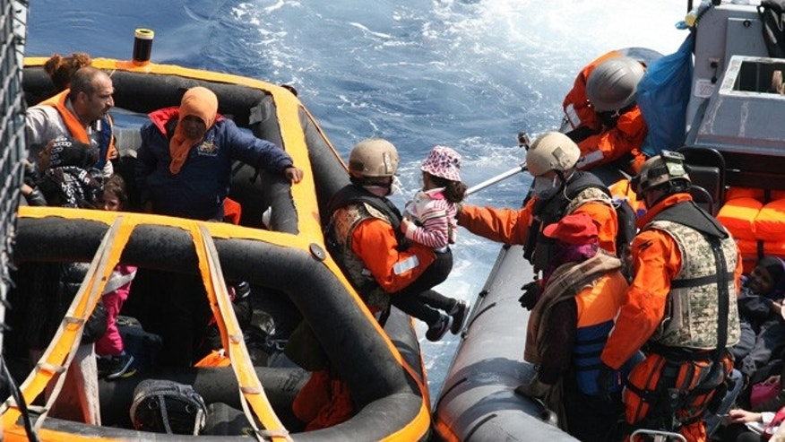 June 6, 2015: photo provided by German Bundeswehr, soldiers of the German frigate 'Hesse' rescue refugees in the Mediterranean Sea.