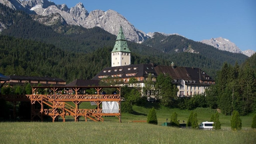 The Schloss Elmau hotel near Garmisch-Partenkirchen, southern Germany, where the G-7 is being held, sits in front of the Alps Sunday, June 7, 2015. (AP Photo/Carolyn Kaster)