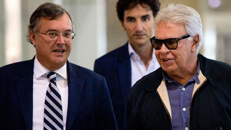 Spain's former president Felipe Gonzalez, right, accompanied by Spain's ambassador in Venezuela Antonio Pérez Hernández, left, arrives at Maiquetia International airport in la Guaira, Venezuela, Sunday, June 7, 2015. Gonzalez is visiting Venezuela where he expects to visit the imprisoned mayor Caracas, Antonio Ledezma and jailed opposition leader Leopoldo Lopez. Gonzalez did not give more details about his agenda at his arrival. (AP Photo/Ariana Cubillos)