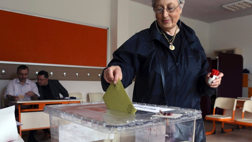 June 7, 2015: Turkish woman Emine Melike Ozmumcu casts her vote at a polling station in a primary school in Ankara, Turkey.