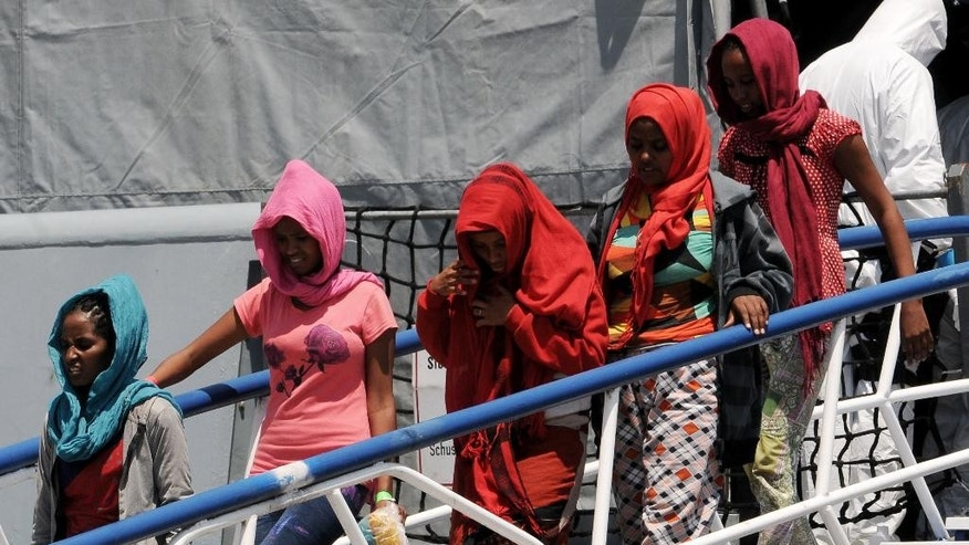 June 7, 2015: Migrants disembark from the German Navy ship Hessen at the Palermo harbor, Italy.