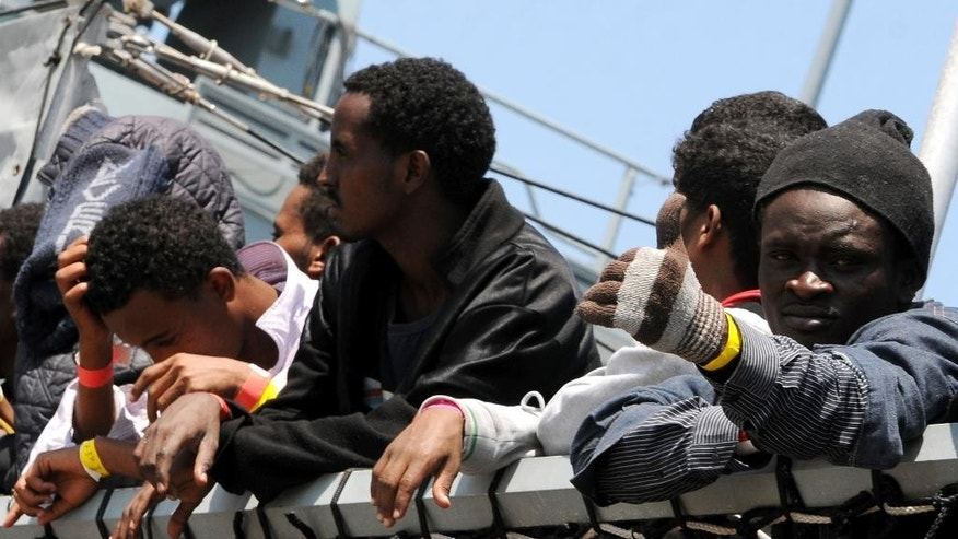 June 7, 2015: Migrants wait to disembark from the German Navy ship Hessen at the Palermo harbor, Italy.