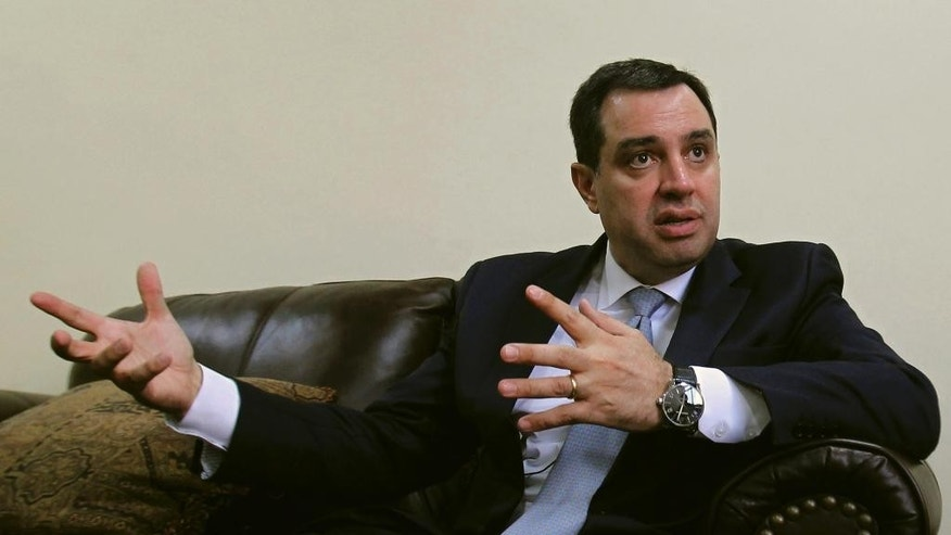 In this Sunday, June 7, 2015 photo, Jordan's Planning Minister Imad Fakhoury speaks during an interview with The Associated Press in Amman, Jordan. Fakhoury said on Sunday the government is studying possible labor policy changes, such as allowing Syrian refugees to work in sectors typically filled by migrant workers. (AP Photo/Raad Adayleh)