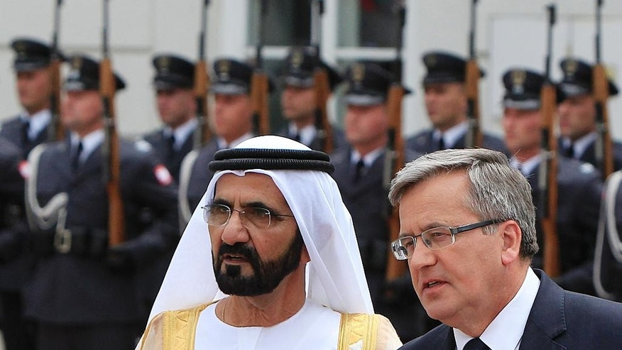 PolishPresident  Bronislaw Komorowski ,right, and Prime Minister  of the United Arab Emirates Sheik Mohammed bin Rashid Al Maktoum attend a welcoming ceremony at the court of presidential palace in Warsaw, Poland, Monday, June 8, 2015. (AP Photo/Czarek Sokolowski)
