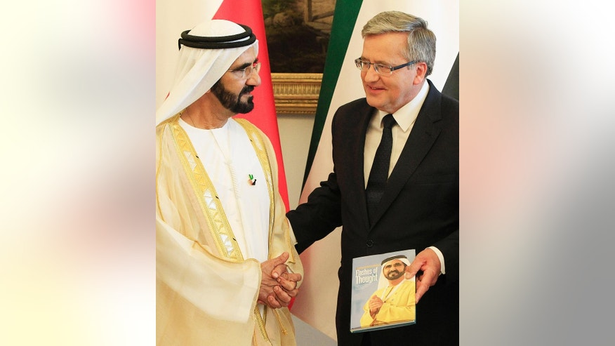 United Arab Emirates Prime Minister , Sheik Mohammed bin Rashid Al Maktoum  is welcomed by  Polish President  Bronislaw Komorowski , right, during welcoming ceremony at the  presidential palace in Warsaw, Poland, Monday, June 8, 2015. (AP Photo/Czarek Sokolowski)