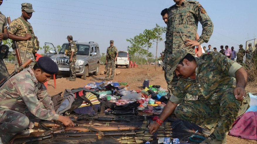 Indian policemen inspect arms and ammunition recovered from Maoist rebels after an encounter in Palamau district in Jharkhand state, India, Tuesday, June 9, 2015. Indian police said they killed at least 12 Maoist rebels in a clash early Tuesday in one of their strongholds in eastern India.(Press Trust of India via AP) INDIA OUT