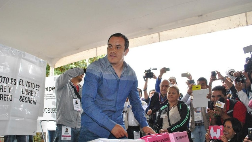 "Mexican soccer star Cuauhtemoc Blanco casts his vote during mid-term elections in Cuernavaca, Mexico, Sunday, June 7, 2015.  Blanco has apparently been elected mayor of Cuernavaca, just south of Mexico City. Known for his pugilistic playing style, Blanco was equally combative at a victory news conference. ""Now I've screwed them,"" he said of his rivals. (AP Photo/Tony Rivera)"