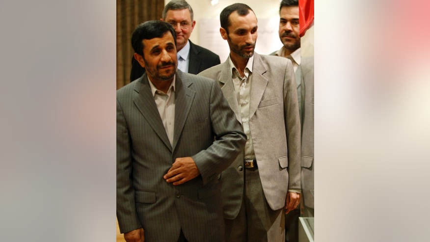 In this photo taken on Sunday, Sept. 12, 2010, then Vice President Hamid Baghaei, second right, and then President Mahmoud Ahmadinejad visit the National Museum in Tehran, Iran. Iranian authorities on Monday, June 8, 2015, arrested Baghaei, who served under Ahmadinejad, in the second such detention of a senior official from the hard-line former leader's administration, the official IRNA news agency reported. (AP Photo/Vahid Salemi)