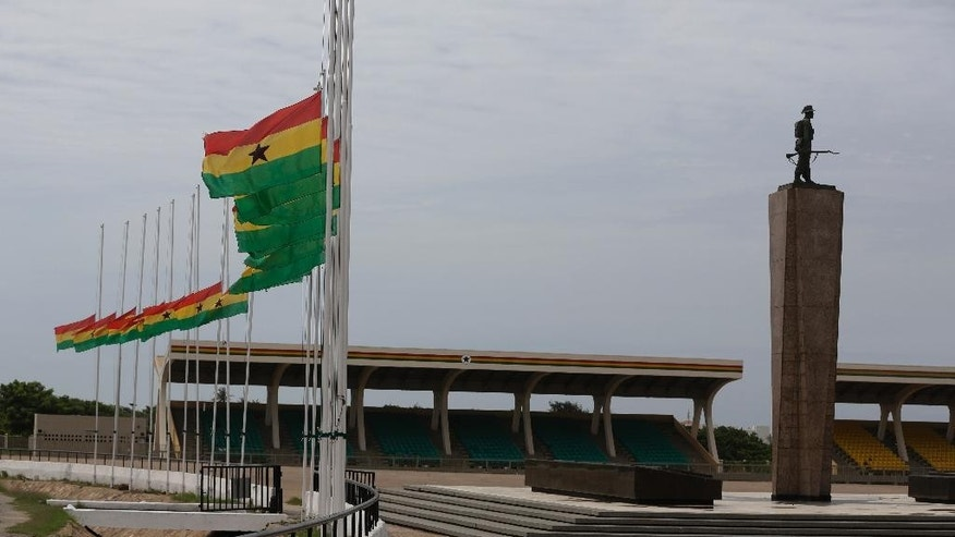 Ghanian flags fly at half mast in the independence square in Accra, Ghana, Monday, June 8, 2015.  Ghana's president, John Dramani Mahama, has declared three days of mourning to begin Monday after a  gas station explosion and flooding in Ghana's capital that killed more than 150 people.  (AP Photo/Sunday Alamba)