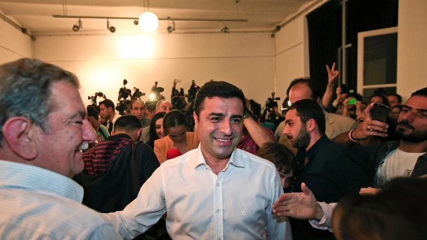 "Selahattin Demirtas, co-chair of the pro-Kurdish Peoples' Democratic Party, (HDP) arrives for a news conference in Istanbul, Turkey, late Sunday, June 7, 2015. In a stunning blow to President Recep Tayyip Erdogan, preliminary results from Turkey's parliamentary election on Sunday suggested that his party could lose its simple majority in Parliament. Demirtas called his party's ability to cross the threshold a ""fabulous victory for peace and freedoms"" that came despite the attack on his party and fierce campaigning by Erdogan. (AP Photo/Lefteris Pitarakis)"