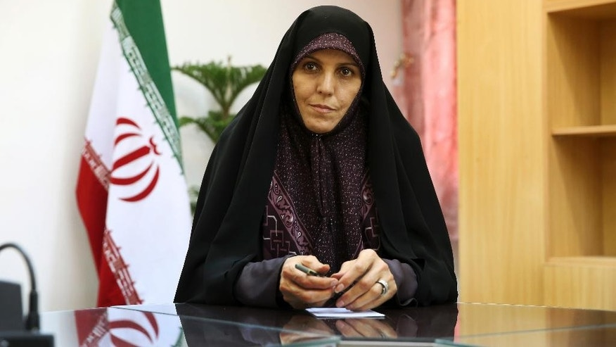 Vice President for Women and Family Affairs Shahindokht Molaverdi listens to a question during an interview with The Associated Press at her office in Tehran, Iran, Monday, June 8, 2015. Molaverdi said a limited number of women will be allowed to watch Volleyball World League games in Tehran later this month as it lifts a ban on Iranian women attending male sporting events. (AP Photo/Ebrahim Noroozi)