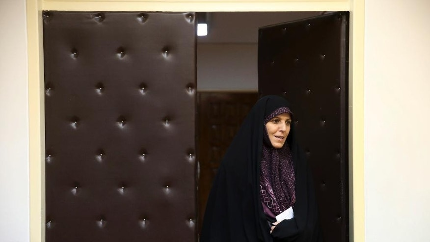 Vice President for Women and Family Affairs Shahindokht Molaverdi arrives for an interview with The Associated Press at her office in Tehran, Iran, Monday, June 8, 2015. Molaverdi said a limited number of women will be allowed to watch Volleyball World League games in Tehran later this month as it lifts a ban on Iranian women attending male sporting events. (AP Photo/Ebrahim Noroozi)