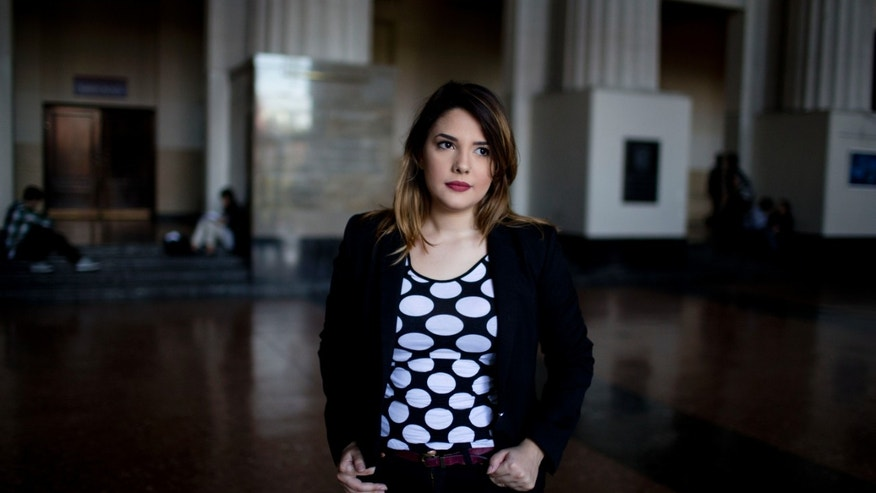 In this May 18, 2015 photo, Aixa Rizzo poses for a picture in Buenos Aires, Argentina. Legislators in Argentina are proposing an anti-catcalling law that could make the practice punishable with a fine. The recently proposed project was sparked by Rizzo, who posted a video online recounting her experience of verbal harassment at the hands of strangers. (AP Photo/Natacha Pisarenko)