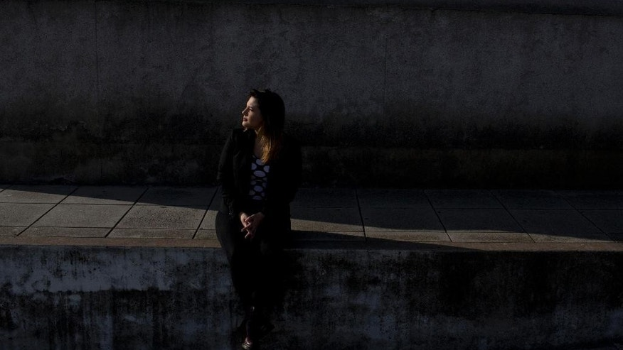 In this May 18, 2015 photo, Aixa Rizzo poses for a picture in Buenos Aires, Argentina. Frustrated by a barrage of sexually-laden comments from male electricians working on a project in her neighborhood, Rizzo in April posted a video on YouTube about her experience.  The video went viral, has now been seen by over half a million people and caused a national debate in the South American country that has often been cited for its machismo culture. (AP Photo/Natacha Pisarenko)