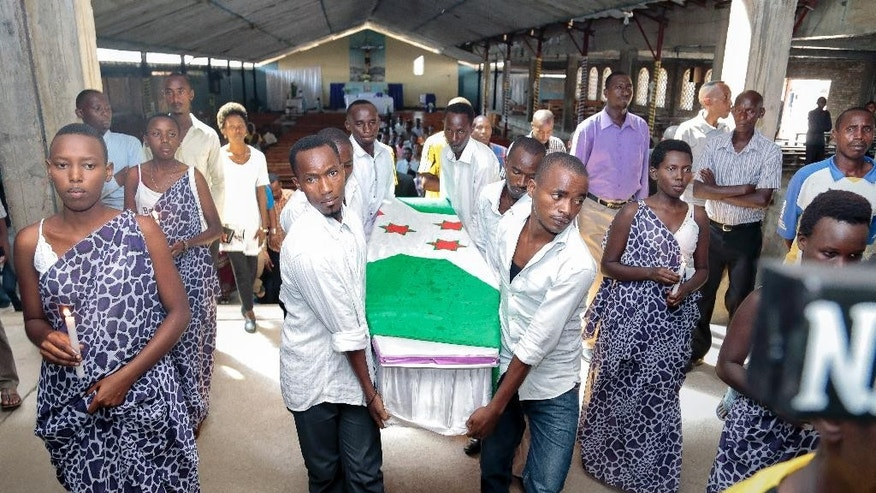 The coffin of Theogene Niyondiko, who was shot dead by police during an opposition demonstration last Friday in the Musaga neighborhood, is carried at his funeral in the capital Bujumbura, Burundi Tuesday, June 9, 2015. Civic groups in Burundi on Tuesday rejected a U.N. facilitator of talks between the government and those opposed to a third term for President Pierre Nkurunziza. (AP Photo/Gildas Ngingo)