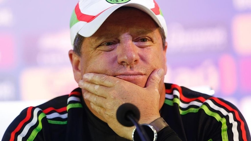 Mexico soccer coach Miguel Herrera attends a press conference after a training session in Sao Paulo, Brazil, Friday, June 5, 2015. The Mexican Soccer Federation opened an investigation Monday, June 8, 2015, of the national team's coach and two players over politically tinged tweets sent the day of the country's recent election. (AP Photo/Andre Penner)