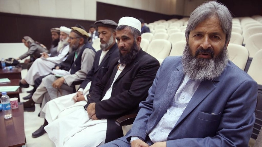 Fazel Ahmad Fazel, first right, newly appointed head of the national teachers' council talks during an interview with the Associated Press in Kabul, Afghanistan, Monday, June 23, 2015. A teachers strike demanding higher pay has shut down at least 27 schools in Afghanistan's capital. Fazel Ahmad Fazel, said Tuesday that 80 schools were closed in Kabul alone, and that teachers are on strike in at least 18 of Afghanistan's 34 provinces. (AP Photo/Massoud Hossaini)