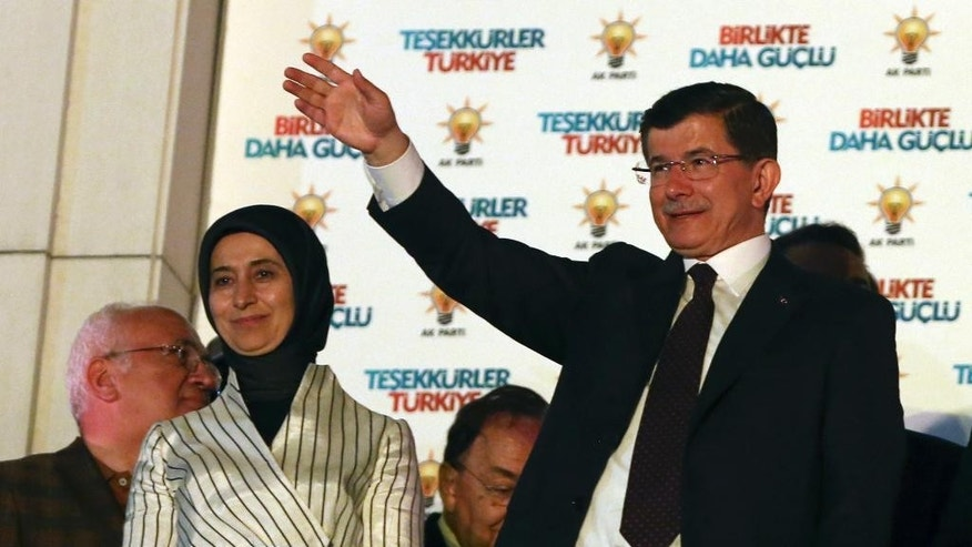 June 7, 2015: Turkey's Prime Minister and leader of ruling Justice and Development Party Ahmet Davutoglu, accompanied by his wife Sare Davutoglu, waves to supporters from the balcony of his party in Ankara, Turkey.