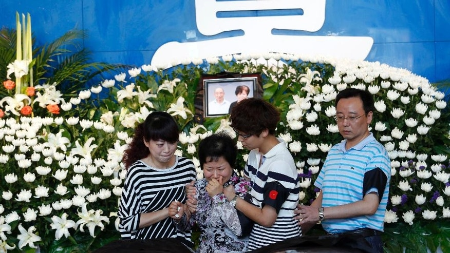 In this Tuesday, June 9, 2015 photo, relatives mourn for victims of the June 1 cruise ship sinking at the funeral house in Jianli county in southern China's Hubei province. China has assembled a 60-strong team to probe last week's river cruise ship sinking following orders from President Xi Jinping to find the cause of the country's worst maritime disaster in nearly seven decades. (Chinatopix Via AP) CHINA OUT