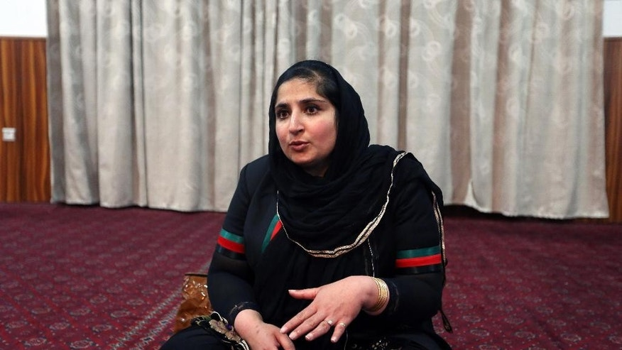 "In this Sunday, May 31, 2015,  photo, Afghan Hindu lawmaker and human rights activist Anarklai Kaur Honaryar speaks during an interview at a Gurdwara, the place of worship for Sikhs, in Kabul, Afghanistan. ""In all provinces they (Sikh and Hindus) owned lands, but unfortunately their lands were taken over by powerful individuals during the fighting,"" Honaryar said. The once-thriving Sikh community is dwindling fast as many choose to leave the country of their birth to escape what they say is growing intolerance and discrimination. (AP Photo/Rahmat Gul)"