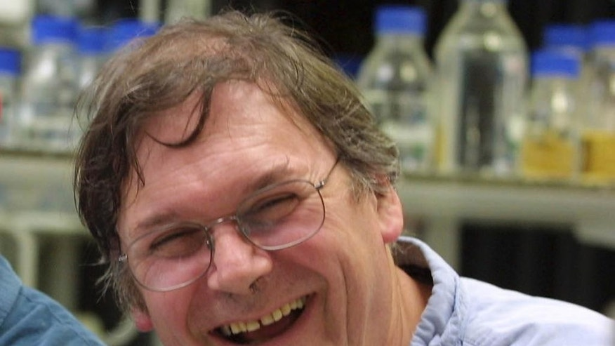 "FILE - A Monday Oct. 8, 2001 photo from files of Dr. Tim Hunt, winner of the Nobel Prize for Medicine, in a laboratory in London. The Nobel Prize-winning British scientist has apologized Wednesday, June 10, 2015, for saying the ""trouble with girls"" working in science labs is that it leads to romantic entanglements and harms science. Tim Hunt made the comments at the World Conference of Science Journalists in South Korea, according to audience members. (AP Photo/Alastair Grant, File)"