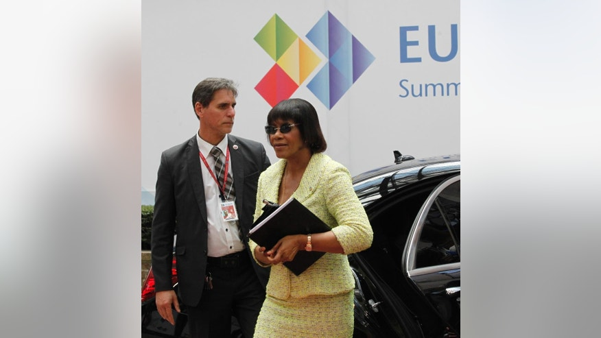 Jamaica's Prime Minister Portia Simpson Miller, center, is greeted as she arrives for the EU-CELAC summit in Brussels on Wednesday, June 10, 2015. European leaders and their Latin America and the Caribbean counterparts meet on a biannual basis in an effort to maintain international and economic ties. (AP Photo/Francois Walschaerts)