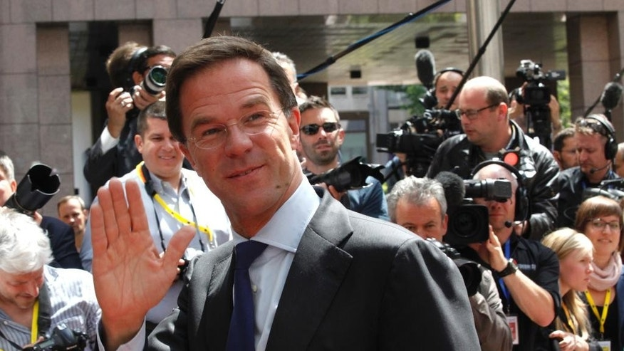 Dutch Prime Minister Mark Rutte, center, waves as he arrives for the EU-CELAC summit in Brussels on Wednesday, June 10, 2015. European leaders and their Latin America and the Caribbean counterparts meet on a biannual basis in an effort to maintain international and economic ties. (AP Photo/Francois Walschaerts)