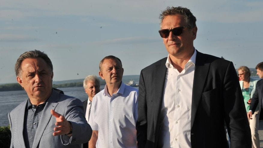 June 9, 2015: FIFA Secretary General Jerome Valcke, right, and Russian Sports Minister Vitaly Mutko, left, walk along an embankment of Volga river in Samara, Russia. Valcke came to attend a 2018 World Cup board meeting.
