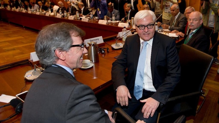 German Foreign Minister Frank-Walter Steinmeier, right, an the UN special representative for Libya, Bernardino Leon, left, pose for the media at the beginning  of a meeting of representatives of Libya and the United Nations in Berlin, Germany, Wednesday, June 10, 2015. (AP Photo/Michael Sohn)