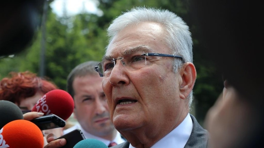 Deniz Baykal, former leader of the main opposition Republican People's Party speaks to the media after a meeting with President Recep Tayyip Erdogan in Ankara, Turkey, Wednesday, June 10, 2015. Opposition parties are likely to demand limits on President Recep Tayyip Erdogan's role in Turkey's next government, complicating coalition talks as the ruling party sought ways Tuesday to remain in power. Prime Minister Ahmet Davutoglu was to meet with Erdogan later Tuesday after their Justice and Development Party, or AKP, lost its parliamentary majority in Sunday's vote.(AP Photo/Burhan Ozbilici)