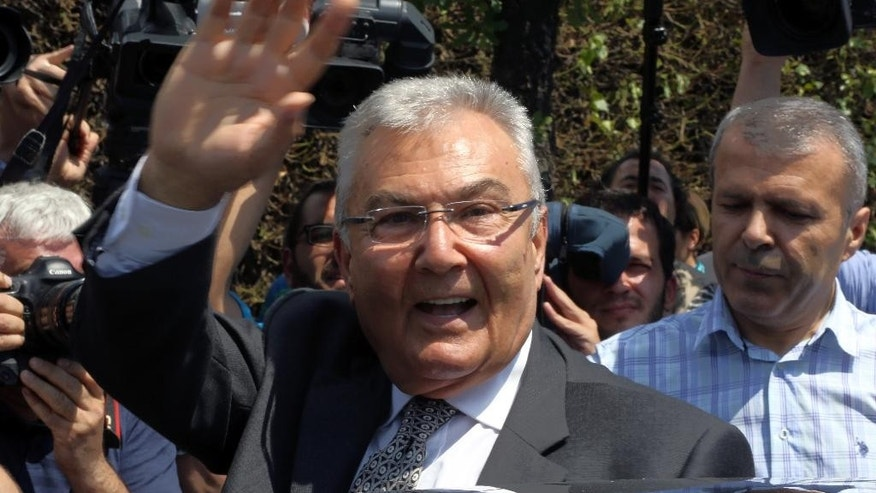 Deniz Baykal, former leader of the main opposition Republican People's Party waves after a meeting with President Recep Tayyip Erdogan in Ankara, Turkey, Wednesday, June 10, 2015. Opposition parties are likely to demand limits on President Recep Tayyip Erdogan's role in Turkey's next government, complicating coalition talks as the ruling party sought ways Tuesday to remain in power. (AP Photo/Burhan Ozbilici)