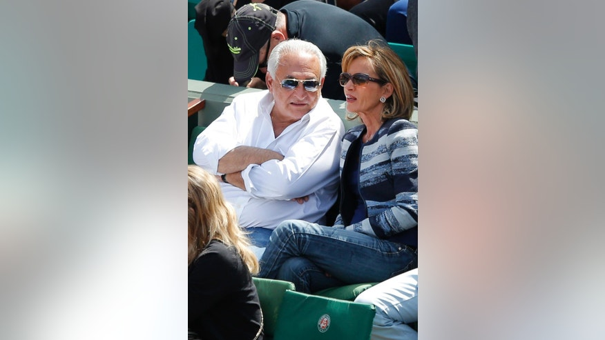 May 30, 2015: This file photo shows former Managing Director of International Monetary Fund Dominique Strauss Kahn talking with his companion Myriam L'Aouffir during the French Open tennis tournament at the Roland Garros stadium.