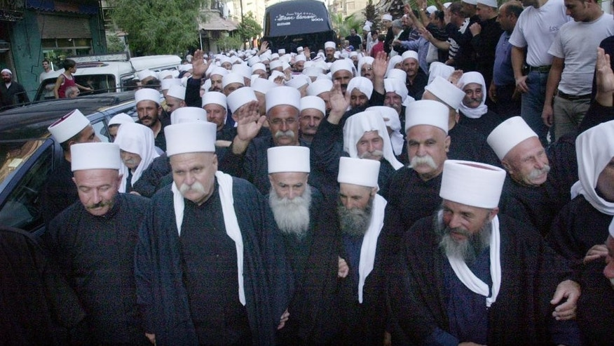 Sept. 6, 2004: In this file photo, Druzses in Jaramana, Syria, 28 miles west of Damascus, greet some 480 Druze clergymen from the Israeli-occupied part of the Golan Heights who crossed into Syria for an annual pilgrimage to a holy shrine in the Syrian countryside.