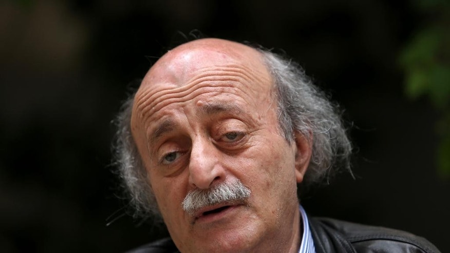 FILE - In this May 28, 2014 file photo, Walid Jumblatt, the political leader of Lebanon's minority Druse sect, speaks during an interview with The Associated Press, as he sits in his garden house, in Beirut, Lebanon. On Thursday, June 11, 2015 an activist group and a Syrian opposition faction said that al-Qaida's affiliate in Syria has killed at least 20 Druze after a confrontation in the northwestern Idlib province, where the jihadi group has forced hundreds of members of the minority sect to covert to Sunni Islam. (AP Photo/Hussein Malla, File)
