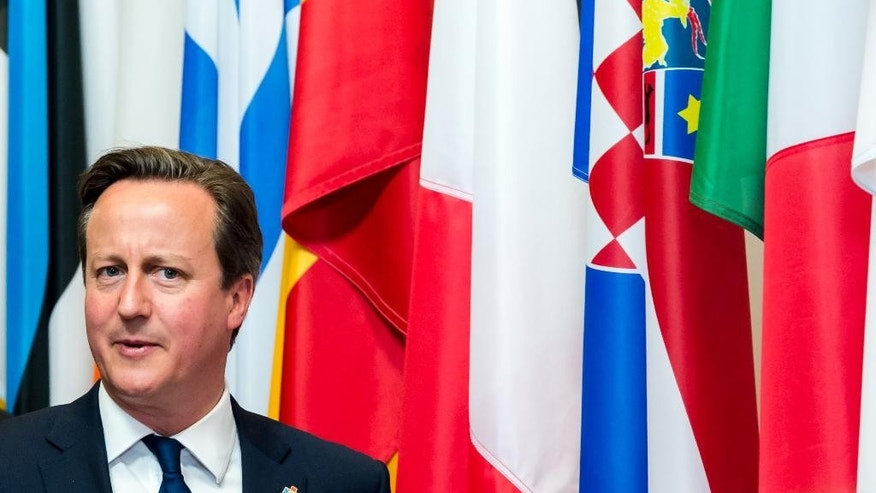 British Prime Minister David Cameron departures from the EU-CELAC summit in Brussels on Thursday, June 11, 2015. Greece's prime minister met with the leaders of Germany and France in Brussels Wednesday, in the latest effort to break a bailout negotiation deadlock that has revived fears his country could default and drop out of the euro. (AP Photo/Geert Vande Wijngaert)