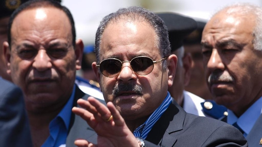 Egypt's Interior Minister Magdy Abdel-Ghaffar, center, visits the site of a suicide bombing near the Karnak Temple in Luxor, Egypt, Thursday, June 11, 2015. Militants tried to attack the ancient temple of Karnak in southern Egypt on Wednesday, with a suicide bomber blowing himself up and two gunmen battling police. No sightseers were hurt in the thwarted assault. (AP Photo/Hassan Ammar)