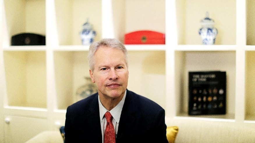 President and CEO of the Associated Press Gary Pruitt, is interviewed ahead of the opening of an exhibit of AP's wartime photographs, Thursday, June 11, 2015, in Hanoi, Vietnam. This month marks the 20th anniversary of restored diplomatic ties between the U.S. and Vietnam. (AP Photo/Wong Maye-E)