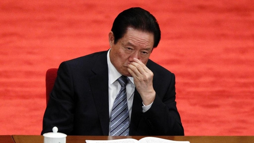 In this May 4, 2012 file photo, Zhou Yongkang, then Chinese Communist Party Politburo Standing Committee member in charge of security, attends a conference to celebrate the 90th anniversary of the founding of Chinese Communist Youth League at the Great Hall of the People in Beijing.