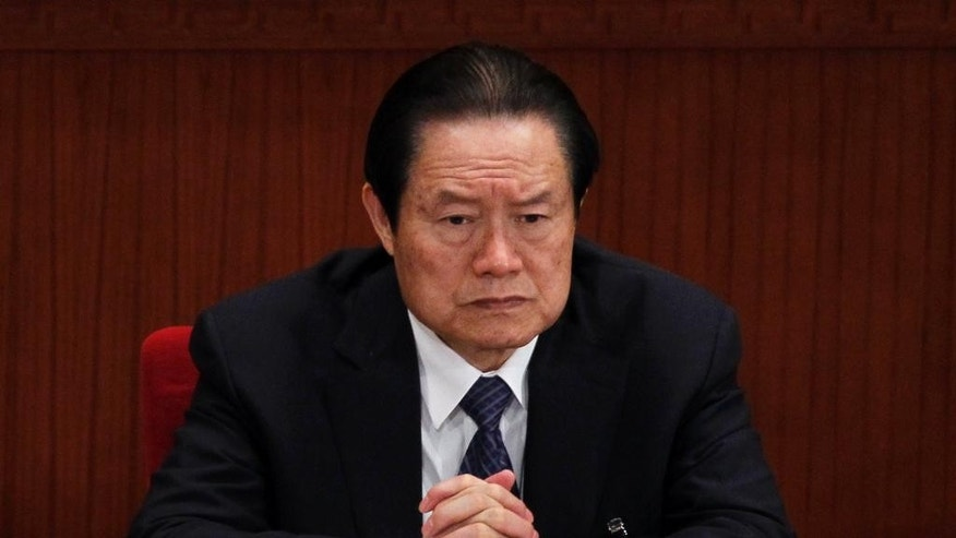 FILE - In this March 9, 2012, file photo, Zhou Yongkang, then Chinese Communist Party Politburo Standing Committee member in charge of security, attends a plenary session of the National People's Congress at the Great Hall of the People in Beijing. According to China's Xinhua News Agency, Zhou was sentenced to life imprisonment Thursday, June 11, 2015 by a court in Tianjin on charges of receiving bribes, abuse of power, and leaking state secrets following a closed-door trial. (AP Photo/Ng Han Guan, File)