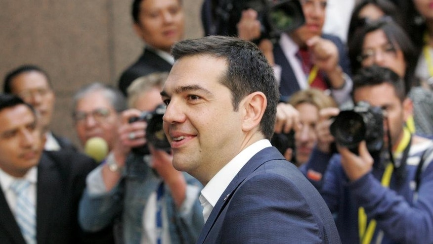 Greek Prime Minister Alexis Tsipras arrives for the EU-CELAC summit in Brussels on Thursday, June 11, 2015. Greek Prime Minister Alexis Tsipras will continue his diplomatic offensive on Thursday to try to convince European creditors to pay out the bailout loans the country needs to avoid default. (AP Photo/Francois Walschaerts)