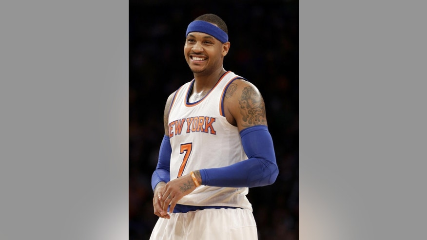 FILE - In this Feb. 1, 2015 file photo, New York Knicks' Carmelo Anthony smiles during the second half of the NBA basketball game against the Los Angeles Lakers, in New York. The NBA star announced Thursday, June 11, 2015, that he is bringing a professional soccer team to Puerto Rico for the first time in three years. (AP Photo/Seth Wenig, File)