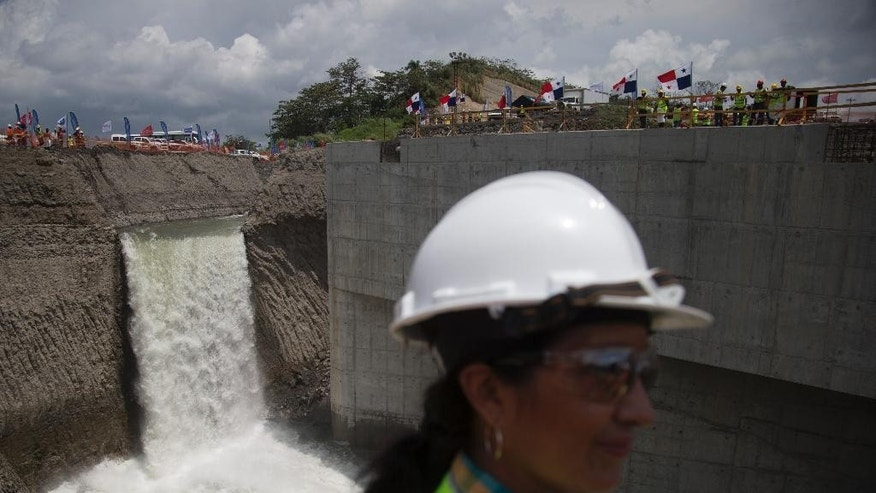 A waterfall is formed as the water from the Atlantic ocean starts to flood the Gatun flood chambers that will provide water to the new set of locks in the Atlantic side of the Panama Canal in Colon, Panama, Thursday, June 11, 2015. Water began flooding into an expanded section of the Panama Canal as engineers begin testing new locks. It's a key step in a project that will affect trade across the world. (AP Photo/Tito Herrera)