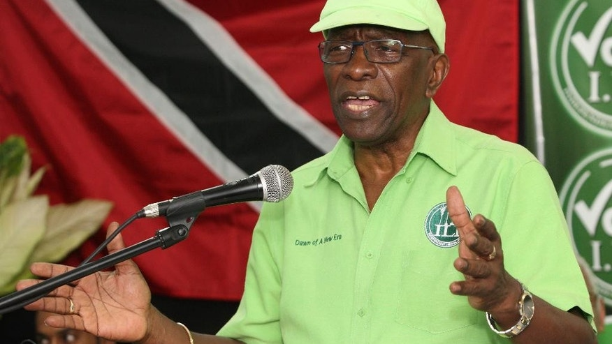 FILE - In this June 3, 2015 file photo, former FIFA vice president Jack Warner speaks at a political rally in Marabella, Trinidad and Tobago. Warner, a former member of Parliament in his homeland, said Wednesday, June 10, 2015, that he intends to resist extradition at a hearing scheduled for July 9. He faces charges that include racketeering and money-laundering. Authorities earlier confiscated his passport, fearing he might flee. (AP Photo/Anthony Harris, File)