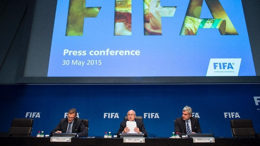 FILE - In this May 30, 2015 file photo FIFA President Sepp  Blatter, center, speaks next to Jerome Valcke, FIFA Secretary General, left, and Walter De Gregorio, Director Communications and Public Affairs, right, during a news  conference following the FIFA Executive Committee meeting in Zurich, Switzerland. Soccer governing body FIFA said Thursday, June 11, 2015 that its director of public affairs Walter De Gregorio is leaving with immediate effect.  (Ennio Leanza/Keystone via AP, file)