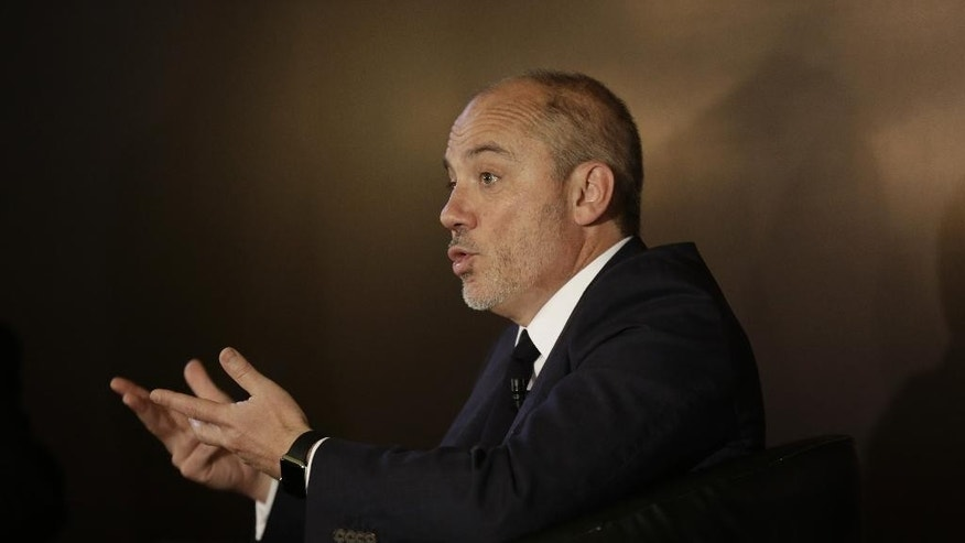 FILE - In this Wednesday, June 3, 2015 file photo, Stephane Richard, the chief executive officer of French mobile phone company Orange, gestures as he speaks during a press conference in Cairo, Egypt. Richard apologized to Israel's prime minister on Friday, June 12, 2015 for his recent comments on pulling out of Israel, saying he opposes the boycott movement against the Jewish state and will continue to invest in it. (AP Photo/Thomas Hartwell, File)