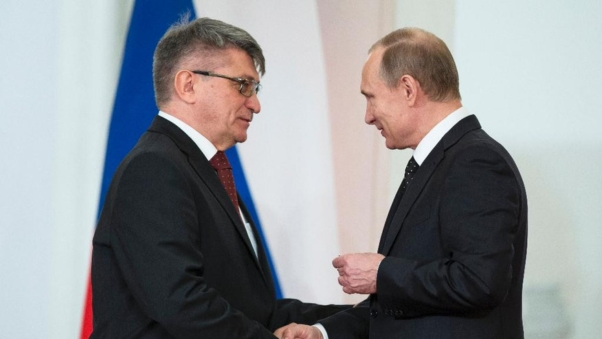 Russian President Vladimir Putin awards  Russian film director Alexander Sokurov during a presentation ceremony of state awards marking the Day of Russia in the Kremlin in Moscow, Russia, Friday, June 12, 2015. The holiday was established after the Soviet breakup to commemorate the emergence of an independent Russia. But there is widespread regret ovet the Soviet collapse, and former president Vladimir Putin renamed the holiday and turned it into a celebration of Russia's resurgence. (AP Photo/Pavel Golovkin)