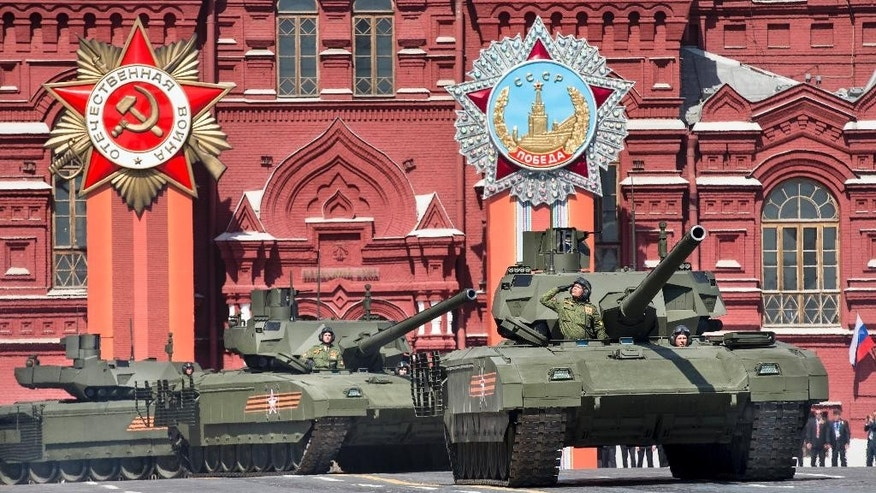 In this photo taken on Saturday, May  9, 2015, Russian T-14 Armata tanks make their way during the Victory Parade marking the 70th anniversary of the defeat of the Nazis in World War II, in Red Square in Moscow, Russia. The Armata, a centerpiece of President Vladimir Putin's military modernization program, is the world's first serially-produced tank to have a remotely controlled turret and a separate, highly-protected internal capsule for the crew. (AP Photo/Alexander Zemlianichenko)
